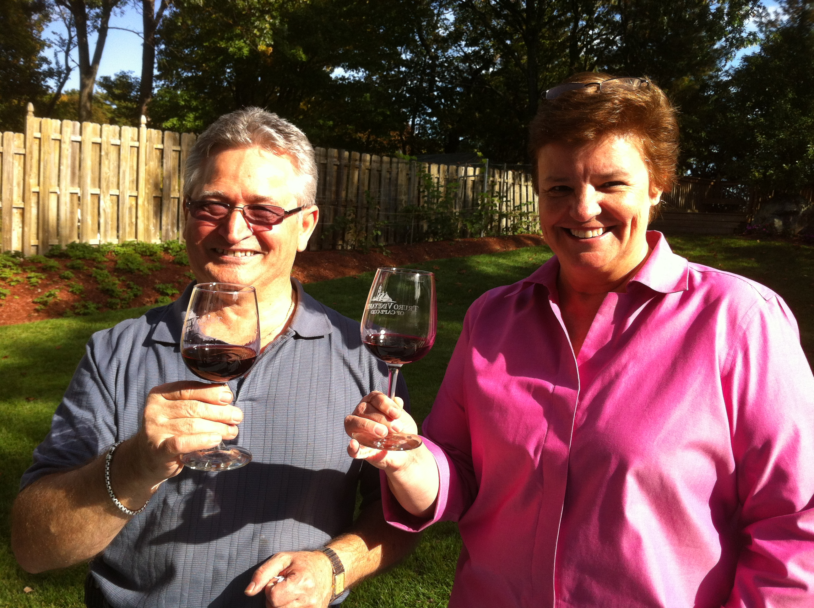 Teresa and Frank sampled the homemade vino. The grape vines were planted along the fence in back.